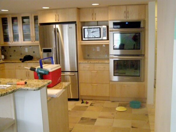 Light colored cabinets in remodel of kitchen room in Denver