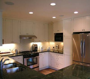 Kitchen with overhead can lights and under-cabinet accent lighting