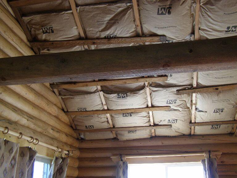 More insulation in custom wood ceiling in remodel of cabin room in Wyoming
