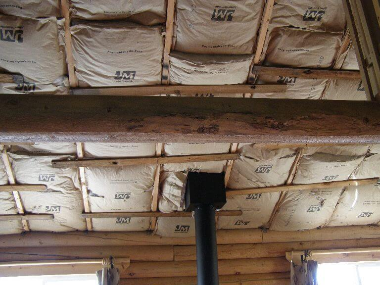 Insulation installed before putting in custom wood ceiling in remodel of cabin room in Wyoming