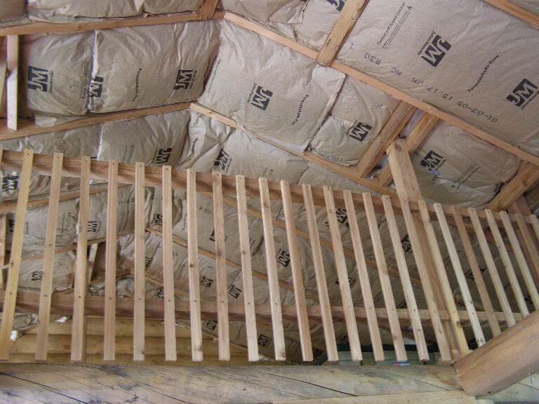 Custom wood railing in remodel of cabin room in Wyoming