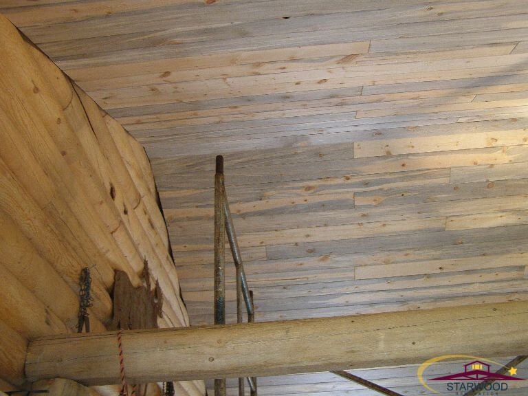 Custom wood ceiling matching beam in remodel of cabin room in Wyoming