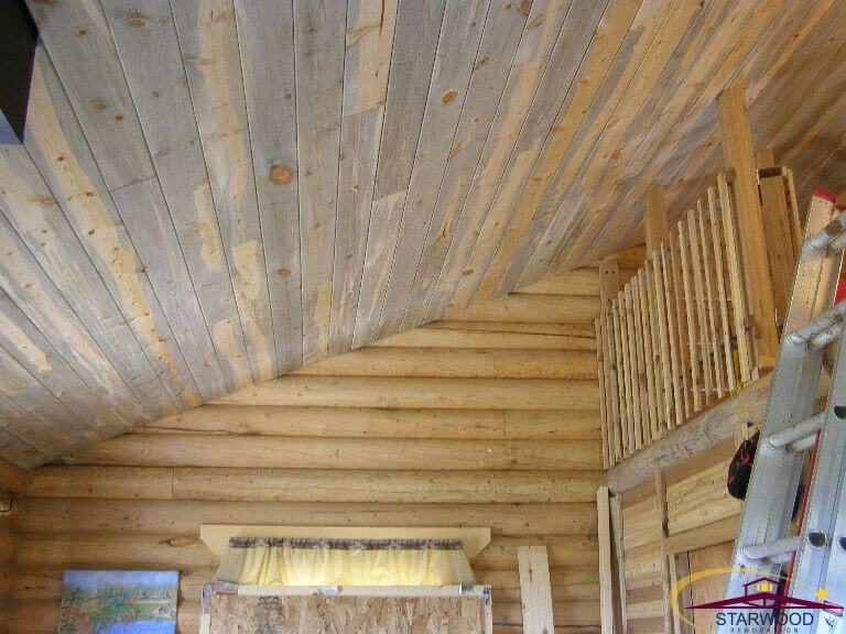 Custom wood ceiling in remodel of cabin room in Wyoming
