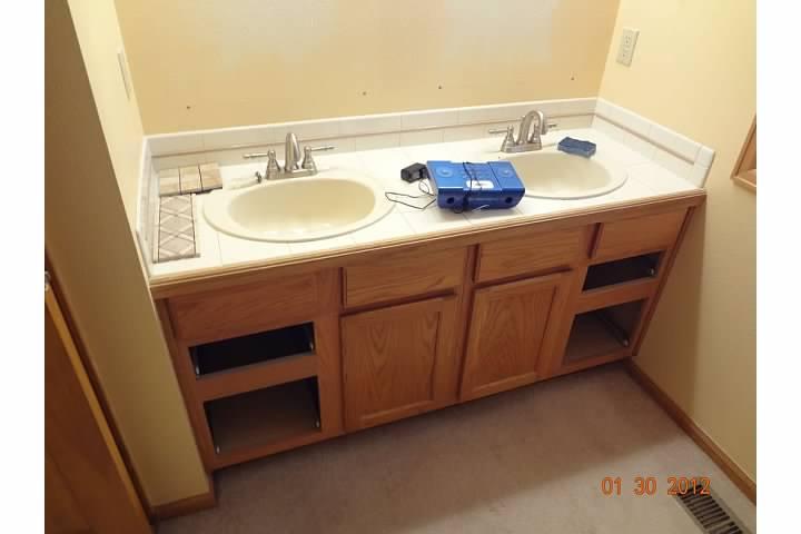 Vanity with dual sinks before remodel of bathroom room in Denver