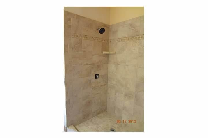New tile shower in remodel of bathroom room in Denver