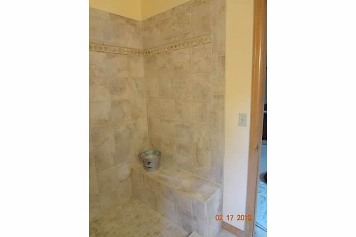 New shower with bench in remodel of bathroom room in Denver