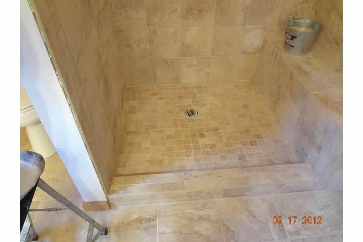 New tiled shower basin in remodel of bathroom room in Denver