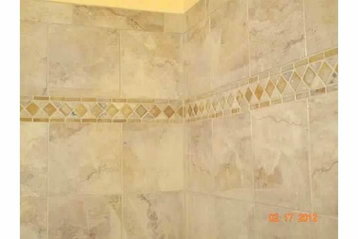 New shower accent tiles in remodel of bathroom room in Denver