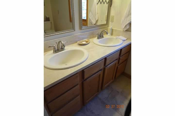 Updated vanity cabinets in remodel of bathroom room in Denver
