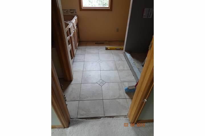 New tile floor in remodel of bathroom room in Denver