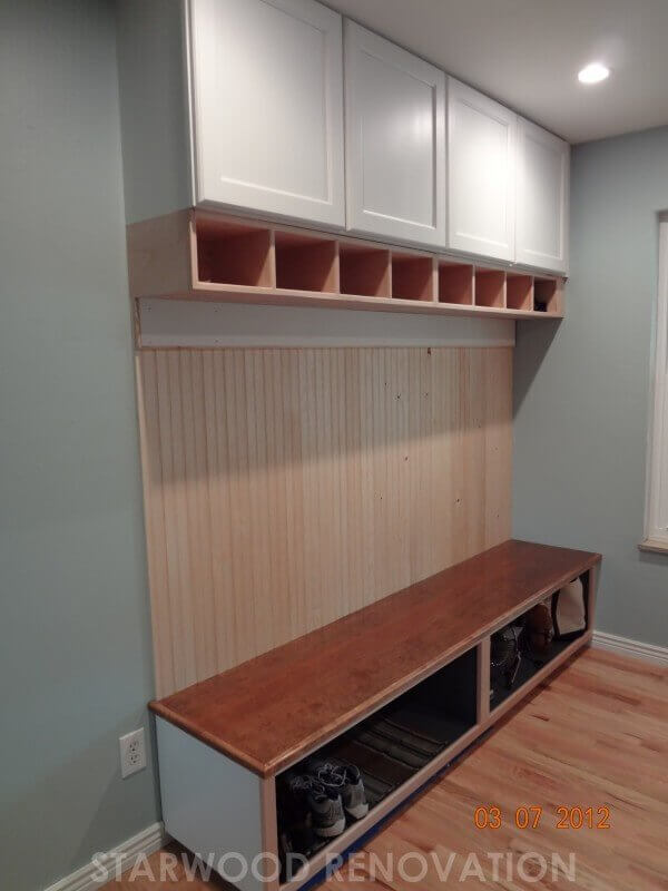 Completed built-in with storage in remodel of mud room room in Denver