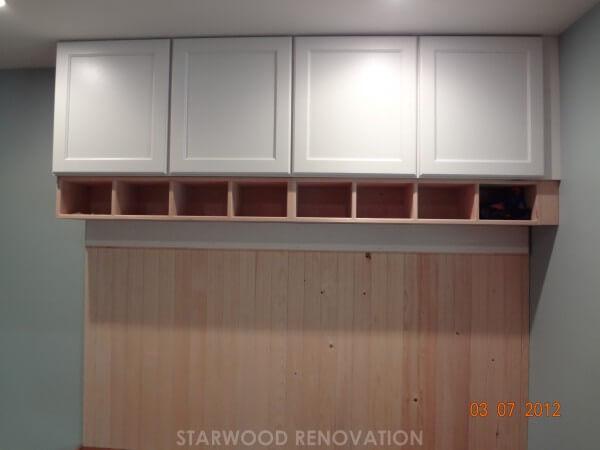 Overhead built-in storage in remodel of mud room room in Denver