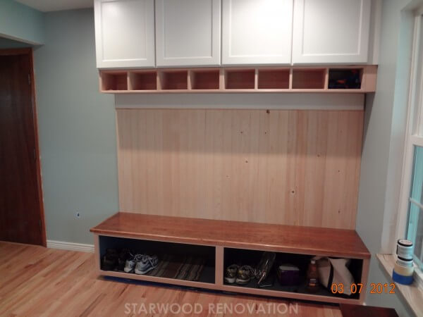 Overhead and under bench built-in storage in remodel of mud room room in Denver