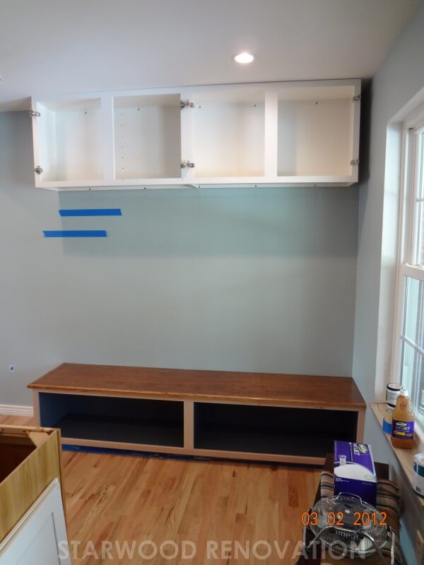 Bench and overhead built-in storage in progress in remodel of mud room room in Denver