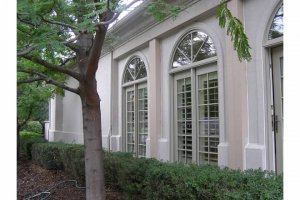 External arched windows on converted patio in Denver