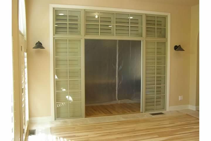Glass-framed internal door inside converted patio in Denver