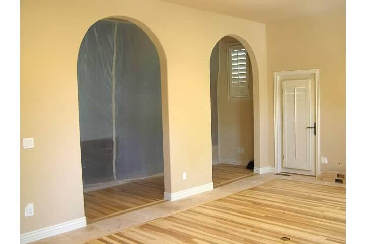 Arched internal doors inside converted patio in Denver