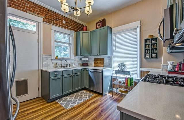 Denver bungalow kitchen remodel with exposed brick wall