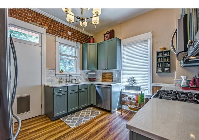 Denver bungalow kitchen remodel with original brick wall
