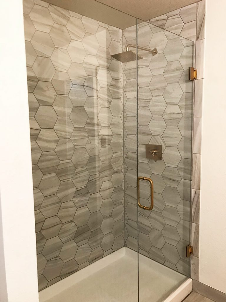Glass shower doors in remodel of bathroom in Golden