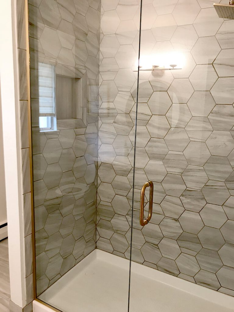 Grey hexagon tile in remodel of bathroom in Golden