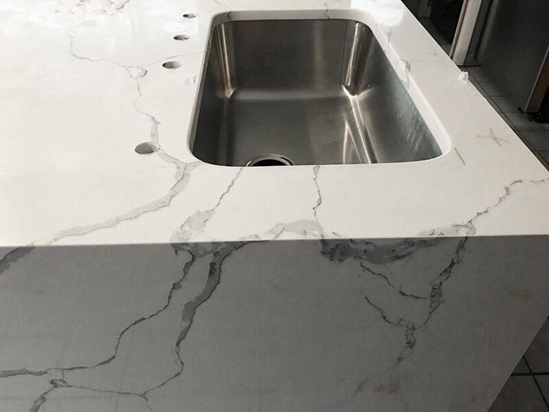 Quartz island sink detail in remodel of kitchen in Golden