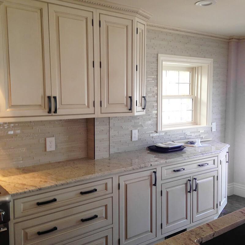 Traditional cabinets with tile backsplash in remodel of kitchen in Denver
