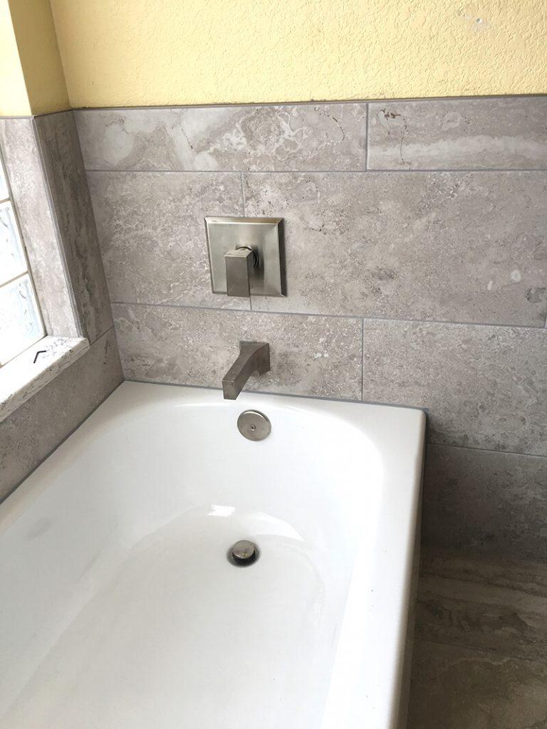 Bathtub with new tile in remodel of bathroom in Lakewood
