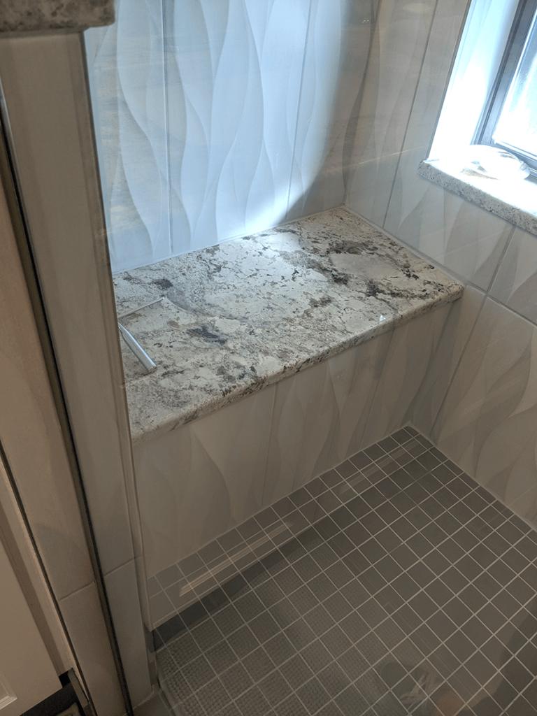Littleton bath remodel granite shower seat