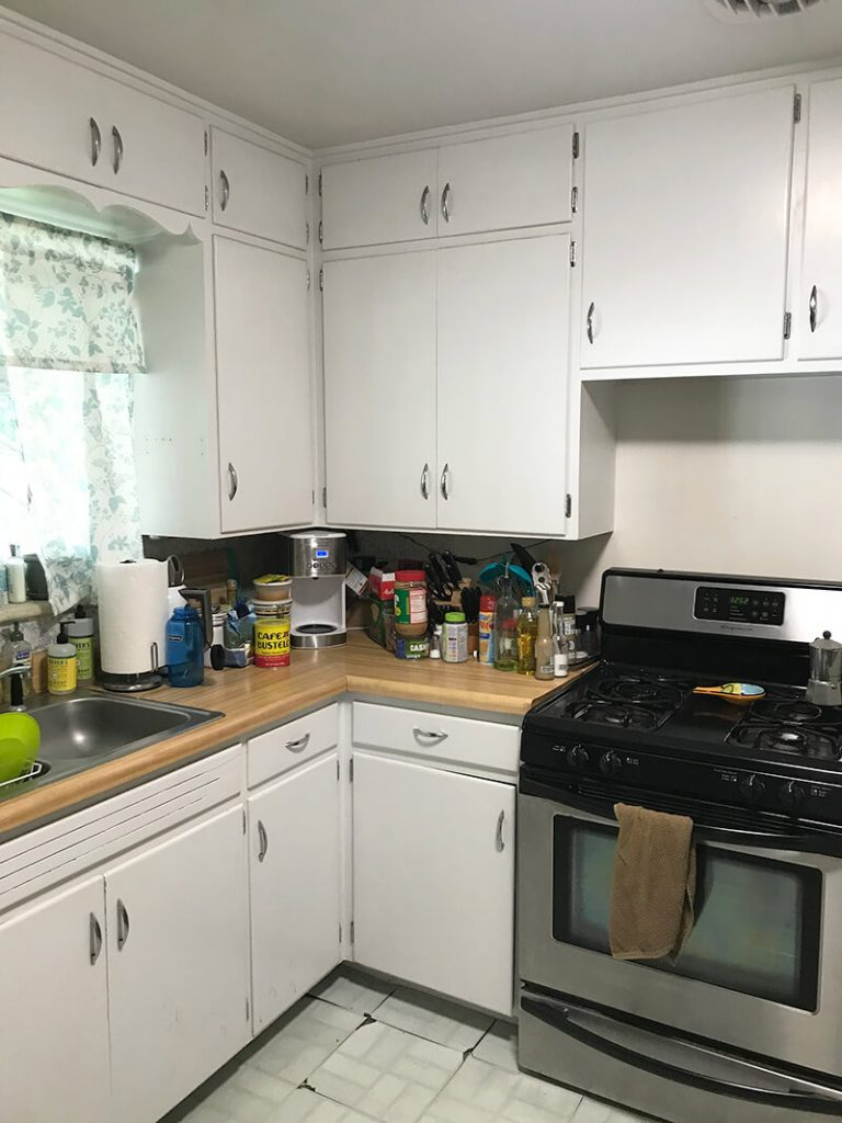 Stove and cabinets before remodel of kitchen in North Denver