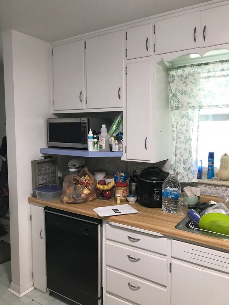 Dishwasher and add-on shelf before remodel of kitchen in North Denver